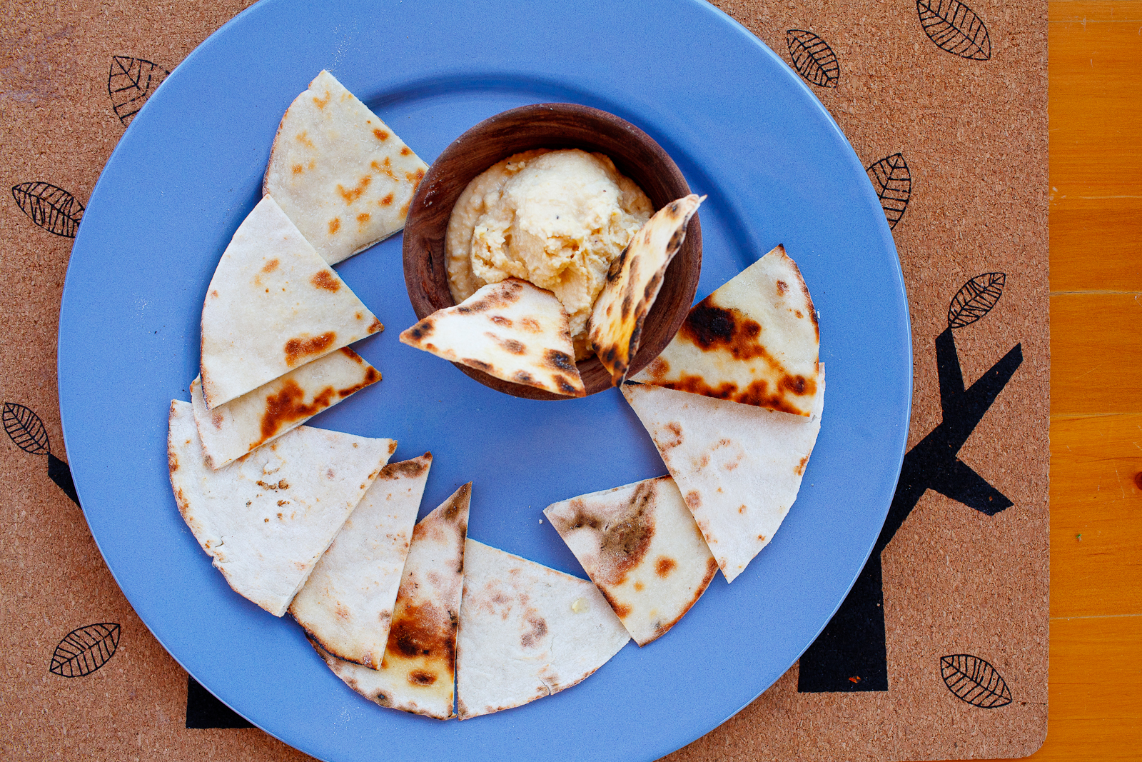 Fire-toasted flatbreads with hummus
