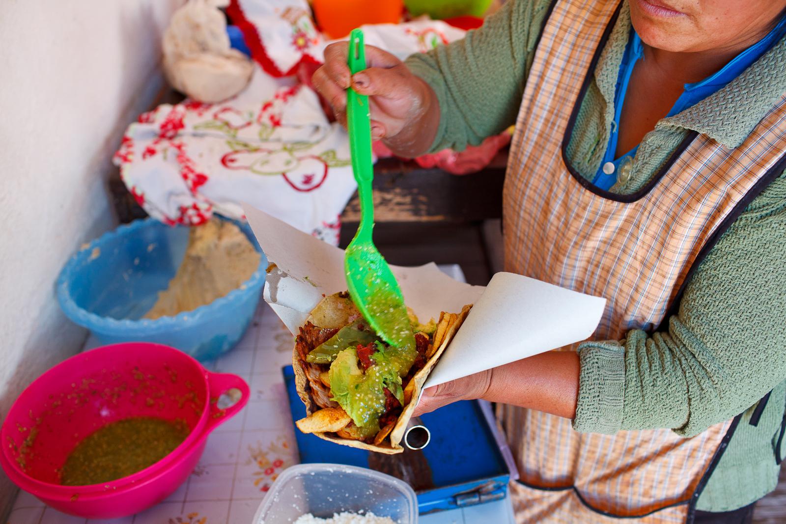 """""""Taco"""" con papas, nopal, quesillo, puerco, y salsa verde"""