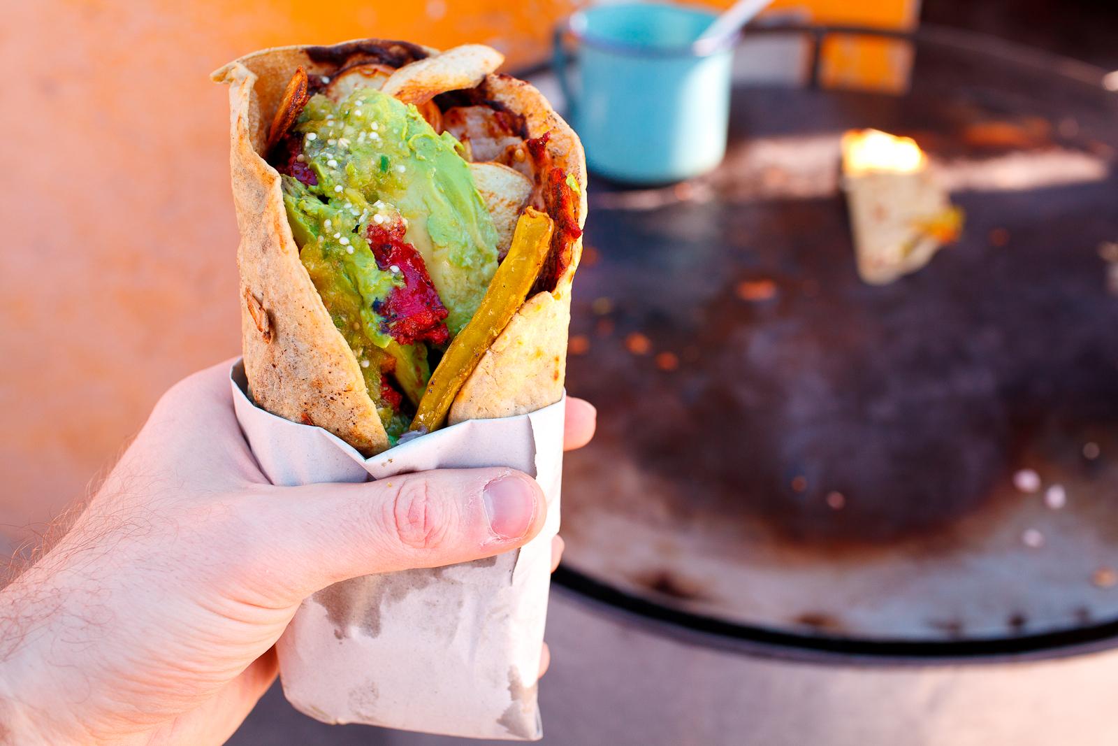 """""""Taco"""" de puerco, papas fritas en manteca de cerdo, nopal, quesillo, longaniza, y salsa verde (Pork """"taco"""" with potato wedges fried in pork fat, nopal,local quesillo cheese,sausage,an tomatillo sauce)"""