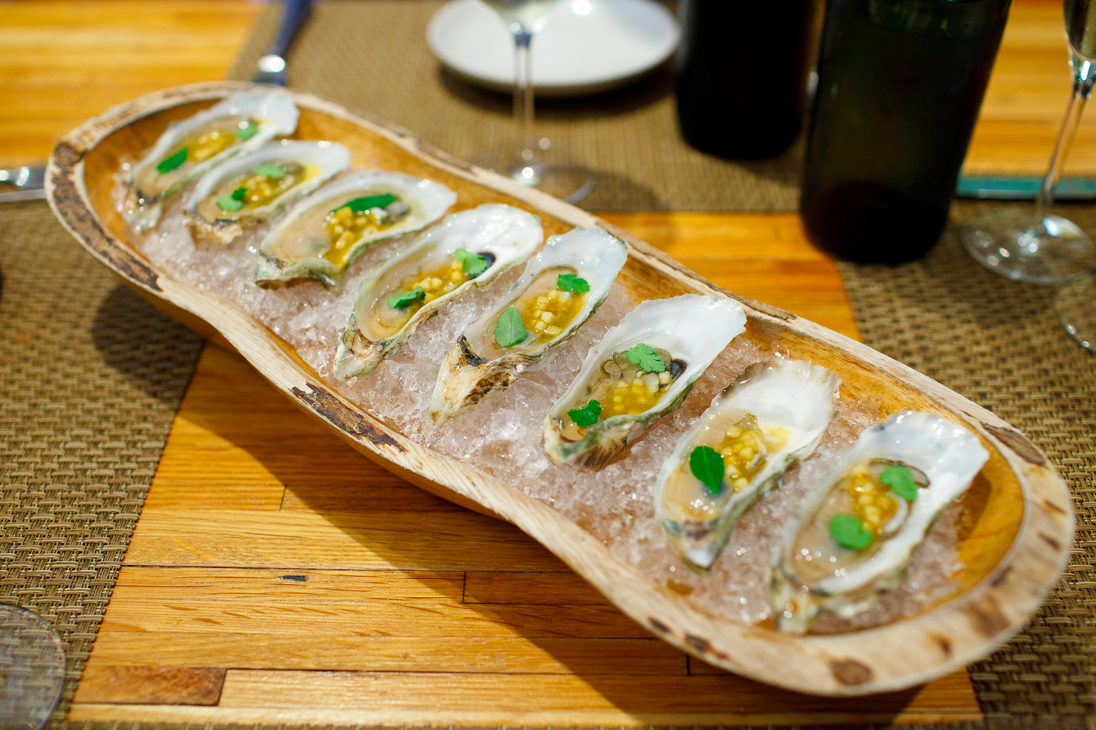 """2nd Course: Oysters from """"clammer Dave,"""" harvested 2-hours ago. Topped with house-fermented rutabaga, lime, and coriander."""