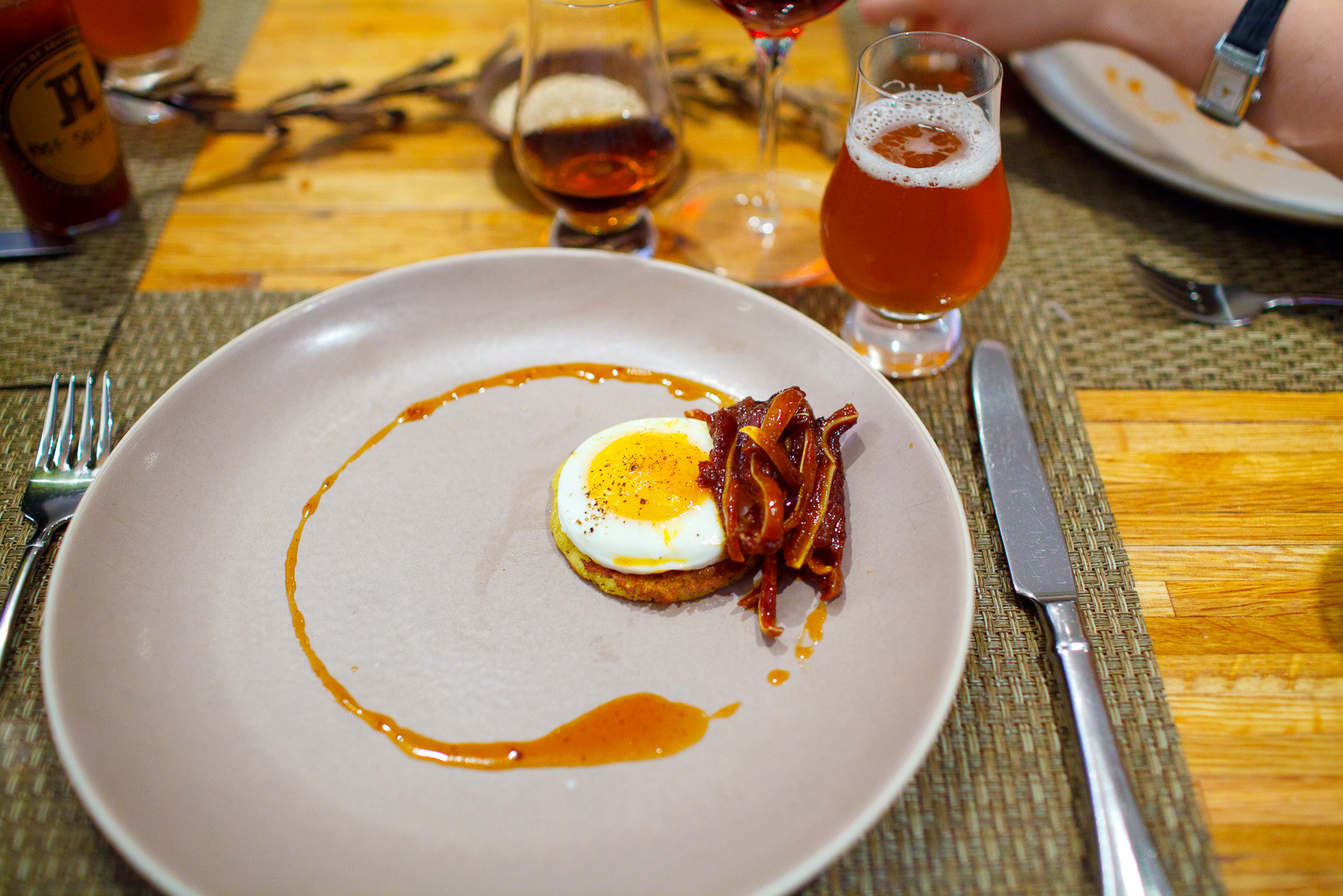 8th Course: Sunny-side up egg on a johnny cake with pig ears.