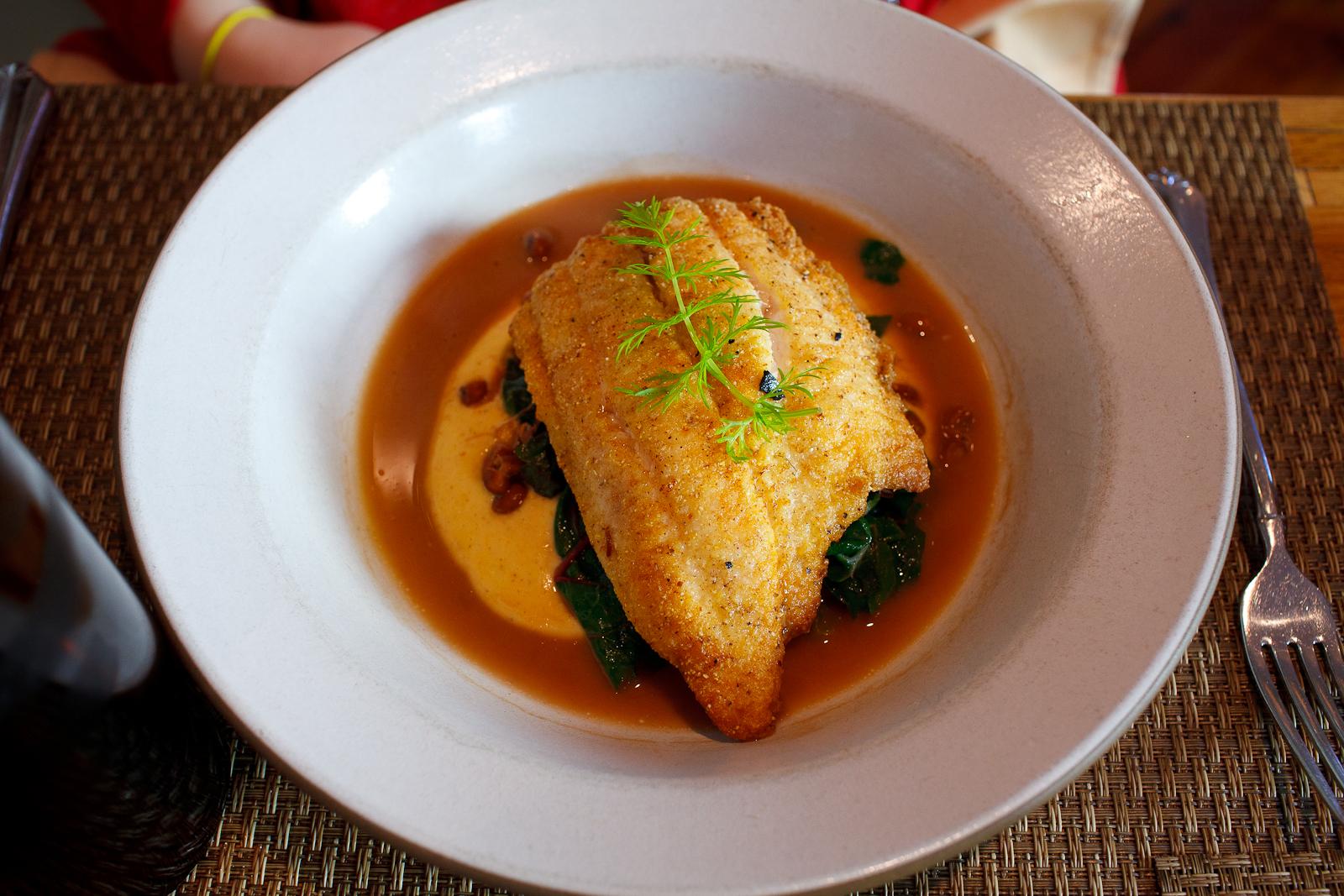 Cornmeal Dusted Catfish with Cornbread Puree, Smoky Sea Island Red Peas and Rainbow Chard