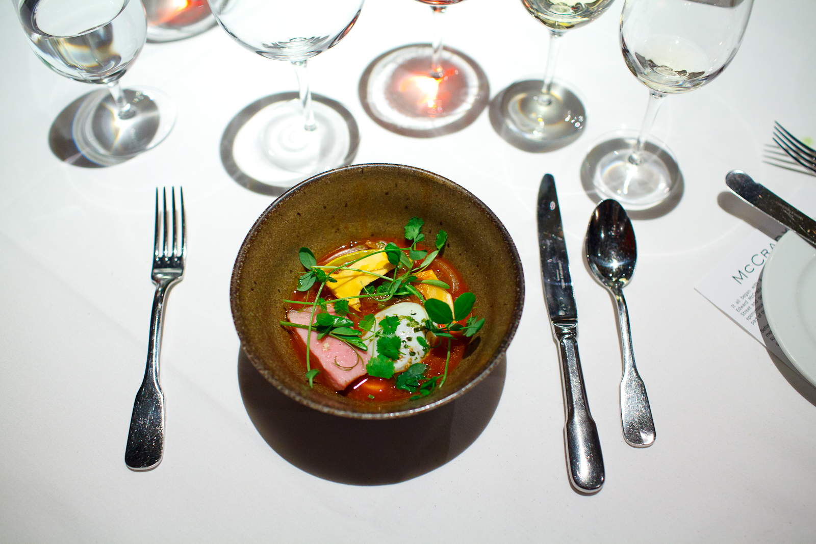5th Course: Broth of fermented red peppers, pork skin noodles, egg poached in pork fat, roasted pork, matsutake mushroom, and English peas