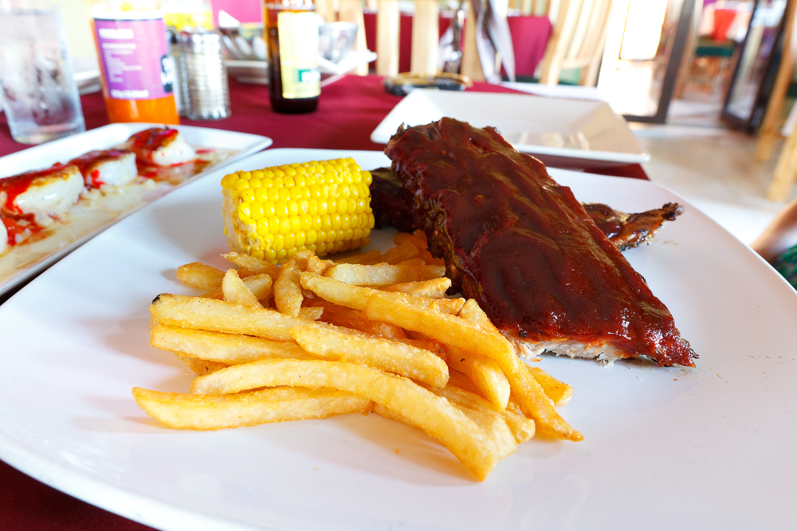 Baby Back Pork Rib, ahumadas y asadas, servidas con elote y papas a la Francesa (Baby back ribs, smoked and grilled, served with corn and french fries) (MXP $200).jpg