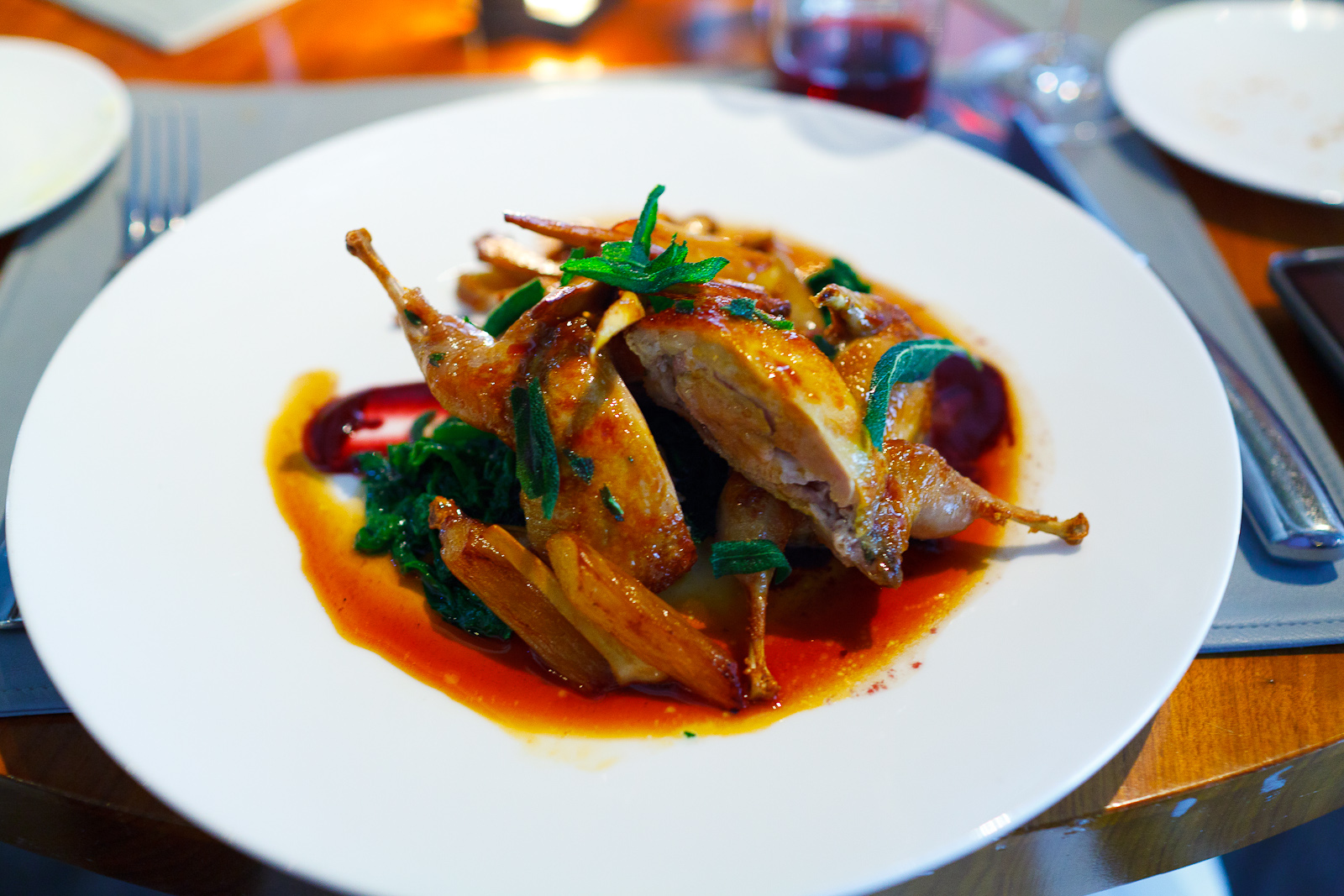 Roasted quail, salsify, concord grapes, mustard greens, chanterelle mushrooms ($29)