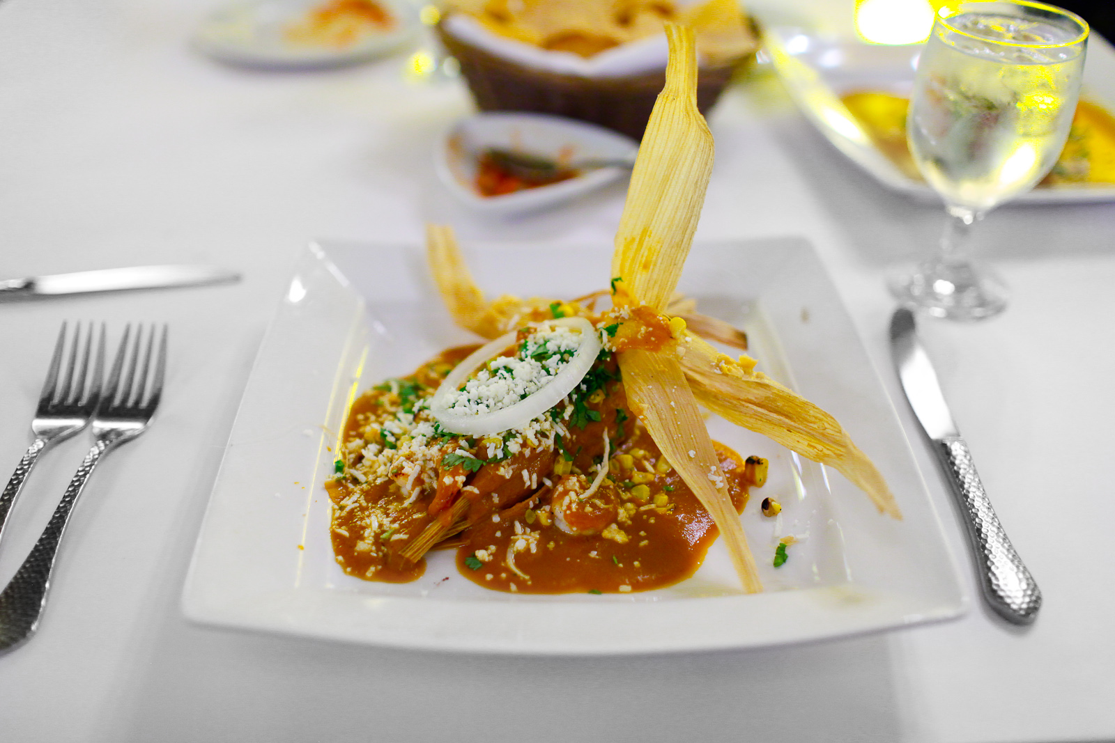 Tamal de elote - fresh corn tamal with seared shrimp, cooked in a chipotle chile cream ($11)