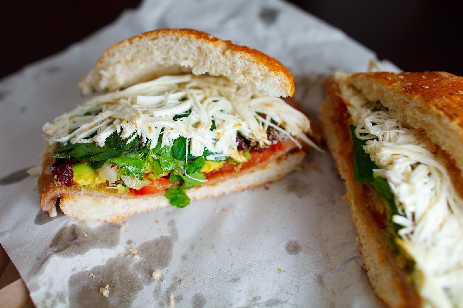 Cemita de rajas y chipotles con milanesa de puerco (Pueblan sandwich with chipotle, chile, and breaded pork), inside shot (35 MXP)