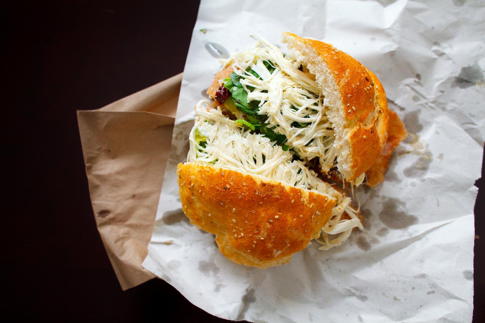 Cemita de rajas y chipotles con milanesa de puerco (Pueblan sandwich with chipotle, chile, and breaded pork) (35 MXP).jpg