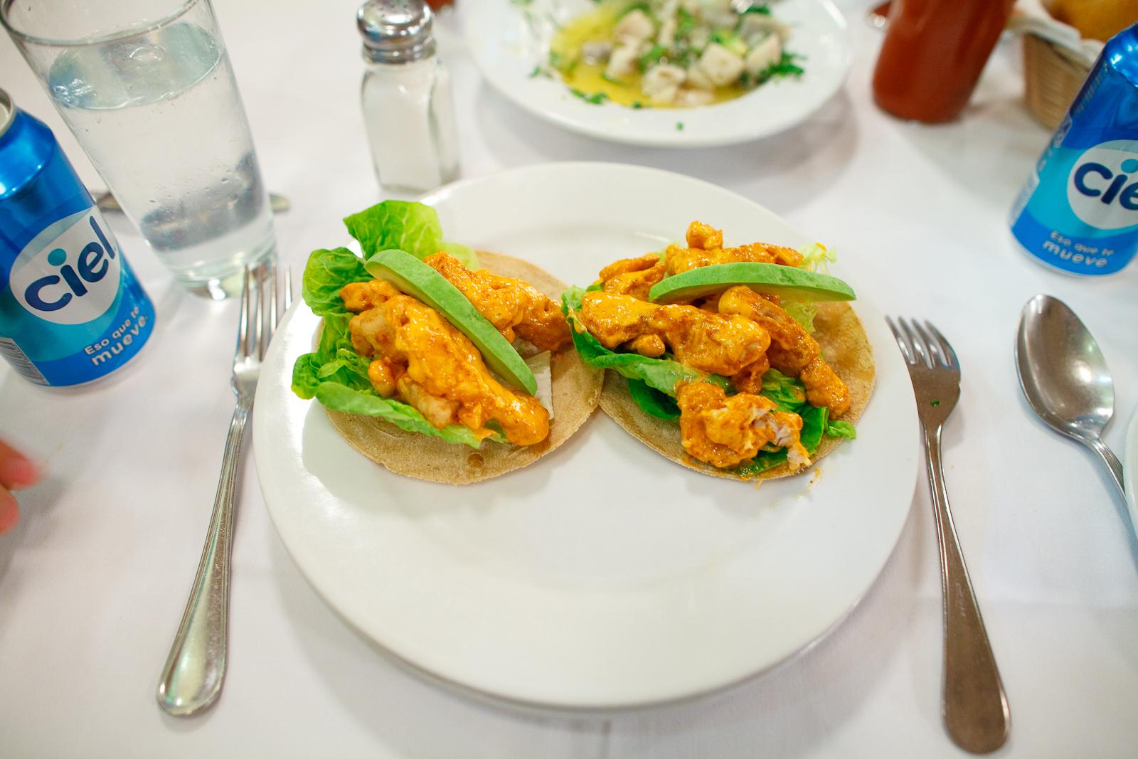 Tacos de pescado empanizado (white fish breaded and fried with spicy mayonnaise)