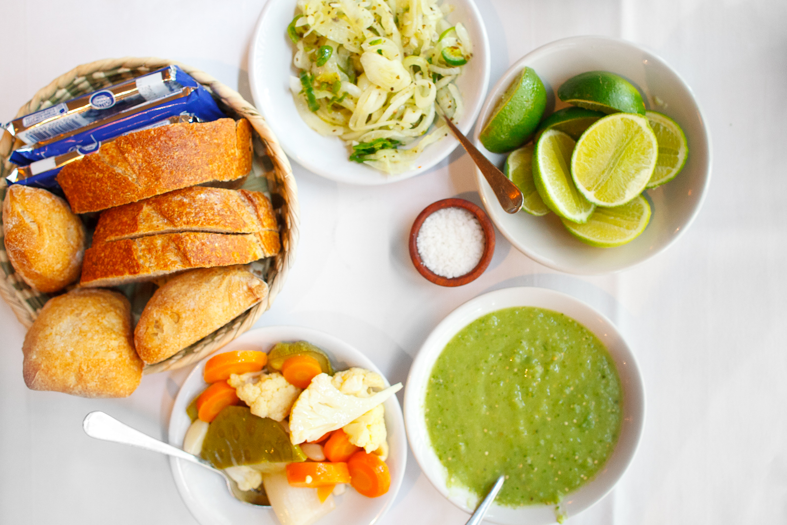Bread, salsas, lime, and pickled vegetables