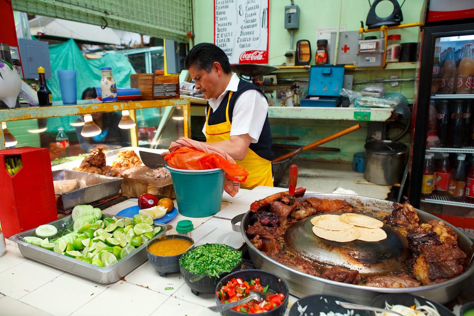 Chopping pork for carnitas
