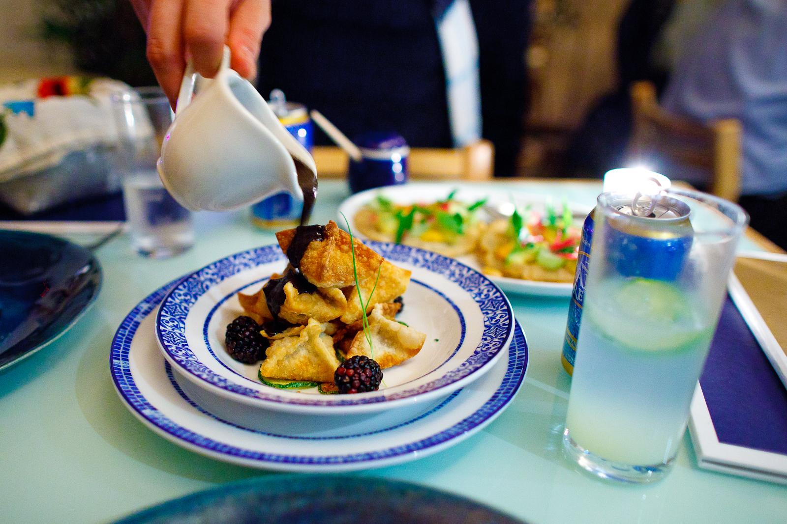 Buñuelos rellenos de pato rostizado, bañados con salsa de mole negro oaxaqueño (Mexican deep-fried dough balls filled with roasted duck, bathed in a black mole from oaxaca) (145 MXP)