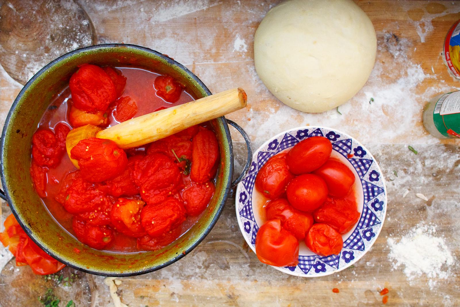Crushing fresh tomatoes for sauce
