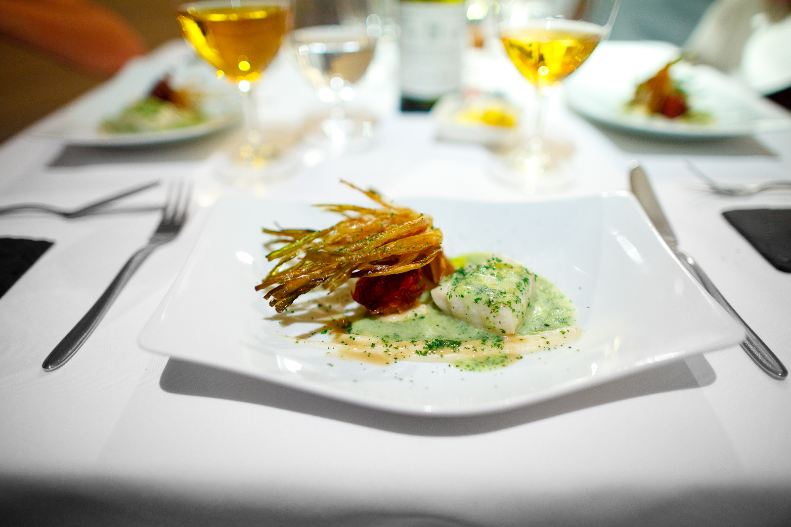 6th Course: Pescado del día con flor de alcachofa (fish of the day with artichoke blossom, sauced