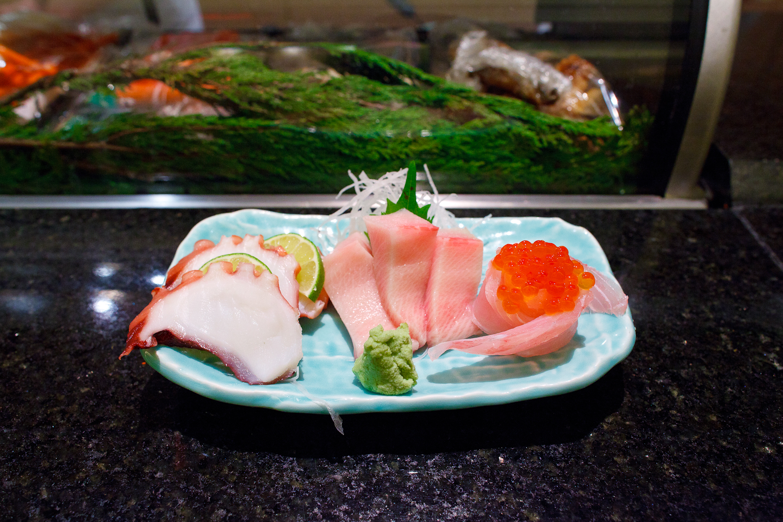 Octopus, yellowtail, and red snapper sashimi with salmon roe