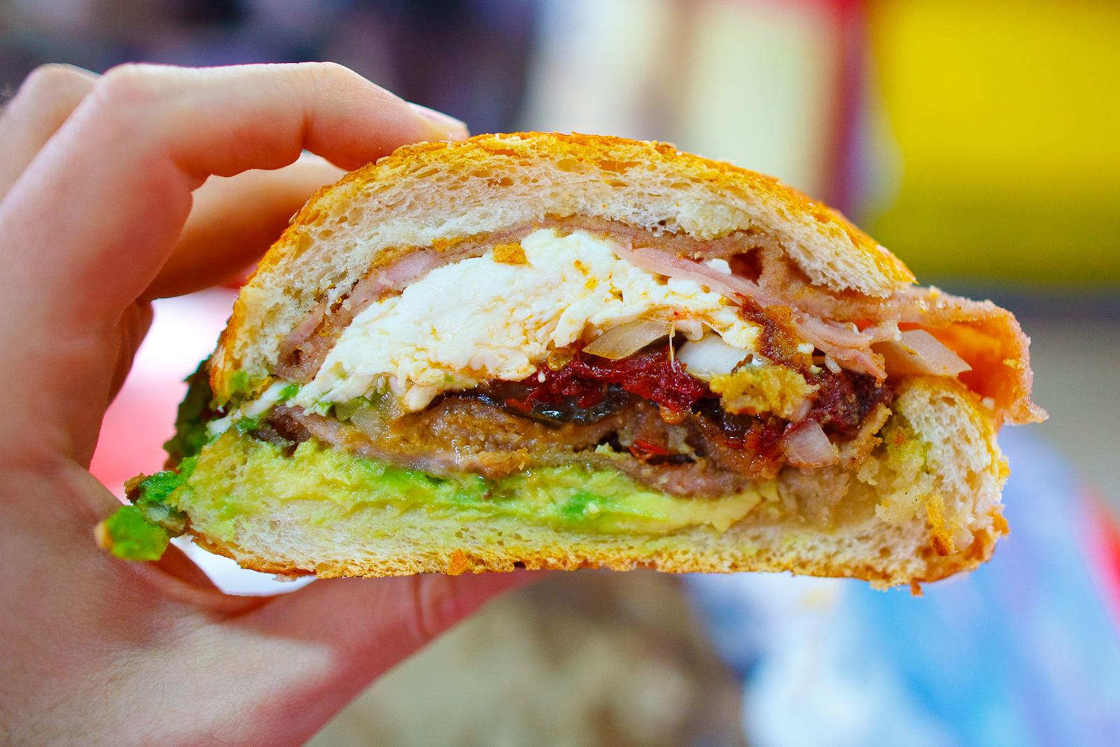 Cemita de milanesa (breaded pork sandwich, chipotle, quesillo, avocado, onion) (25 MXP)