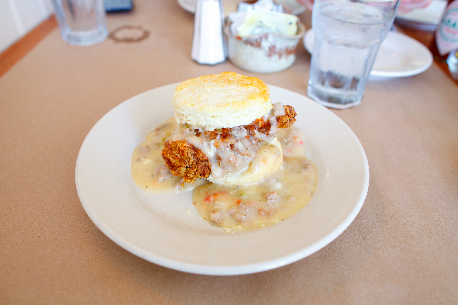 Big nasty biscuit with fried chicken breast, cheddar cheese, and sausage gravy ($6.50)