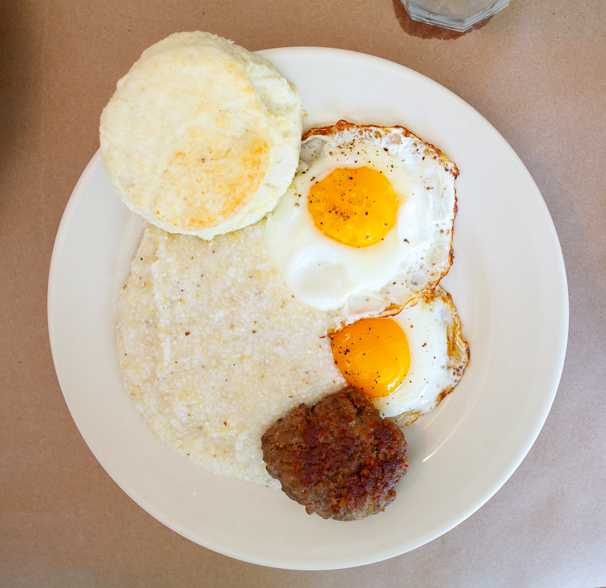 Two eggs sunny side up with Hominy grits and a biscuit ($7)