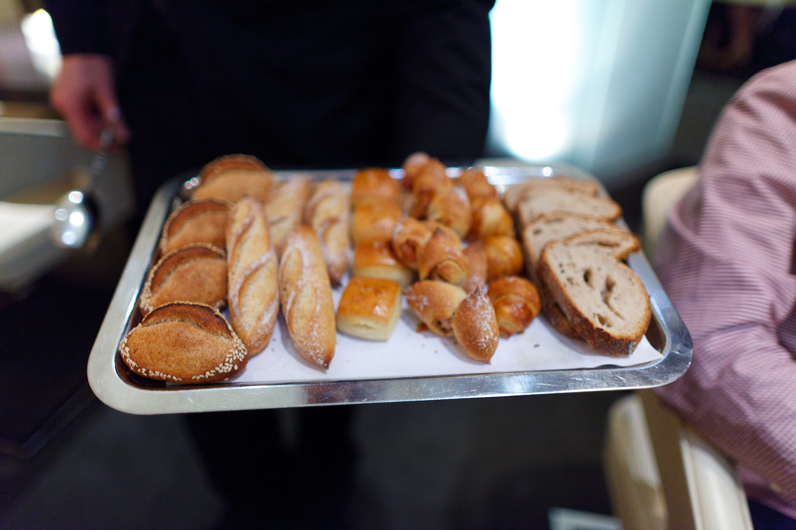 Bread presentation: sesame, baguette, pain au lait, bacon bread, rosemary croissant, sourdough