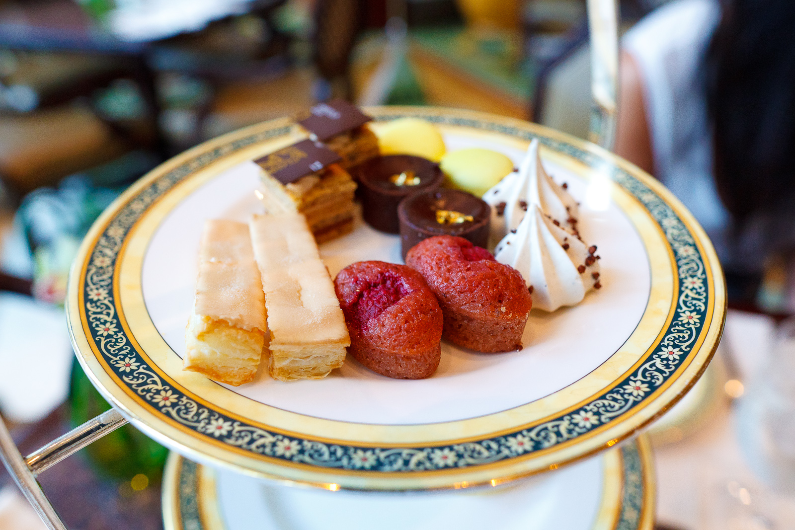 "Earl grey meringue, ""le russe"" pralin, golden chocolate tart, raspberry financier, allumette ""royale,"" lemon macaron"