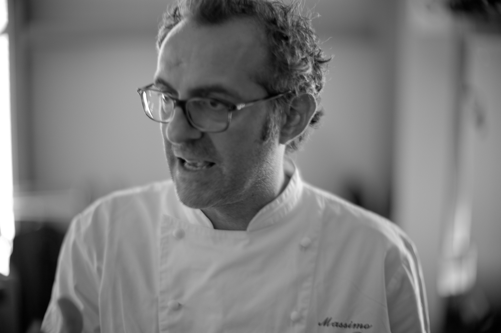 "Portrait of Massimo Bottura. ""Put down your fork and knife at least once during your meal and touch your food."""
