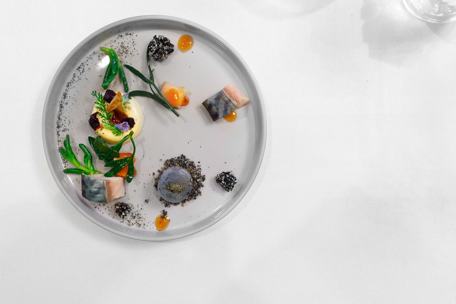Amuse bouche: Marinated mackerel, passion fruit, and black sesame ice cream