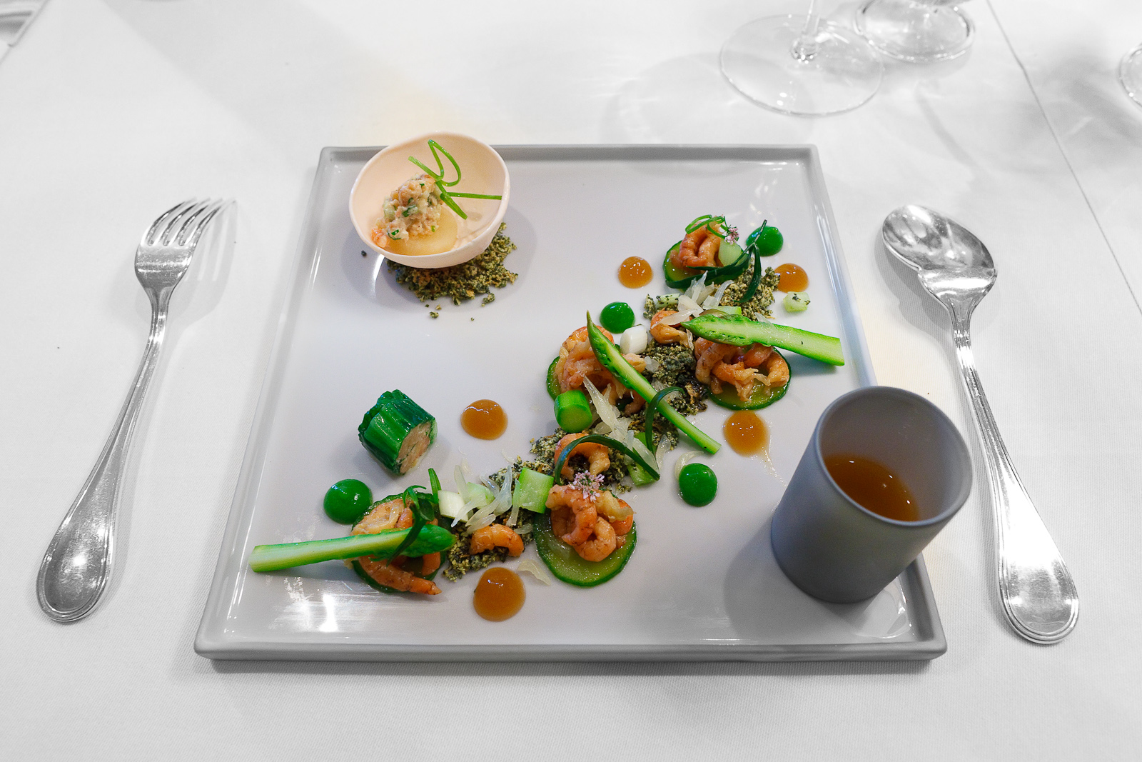 "1st Course: Shrimps from Büsum, cucumber, green asparagus and leek, some ""beach sand"""