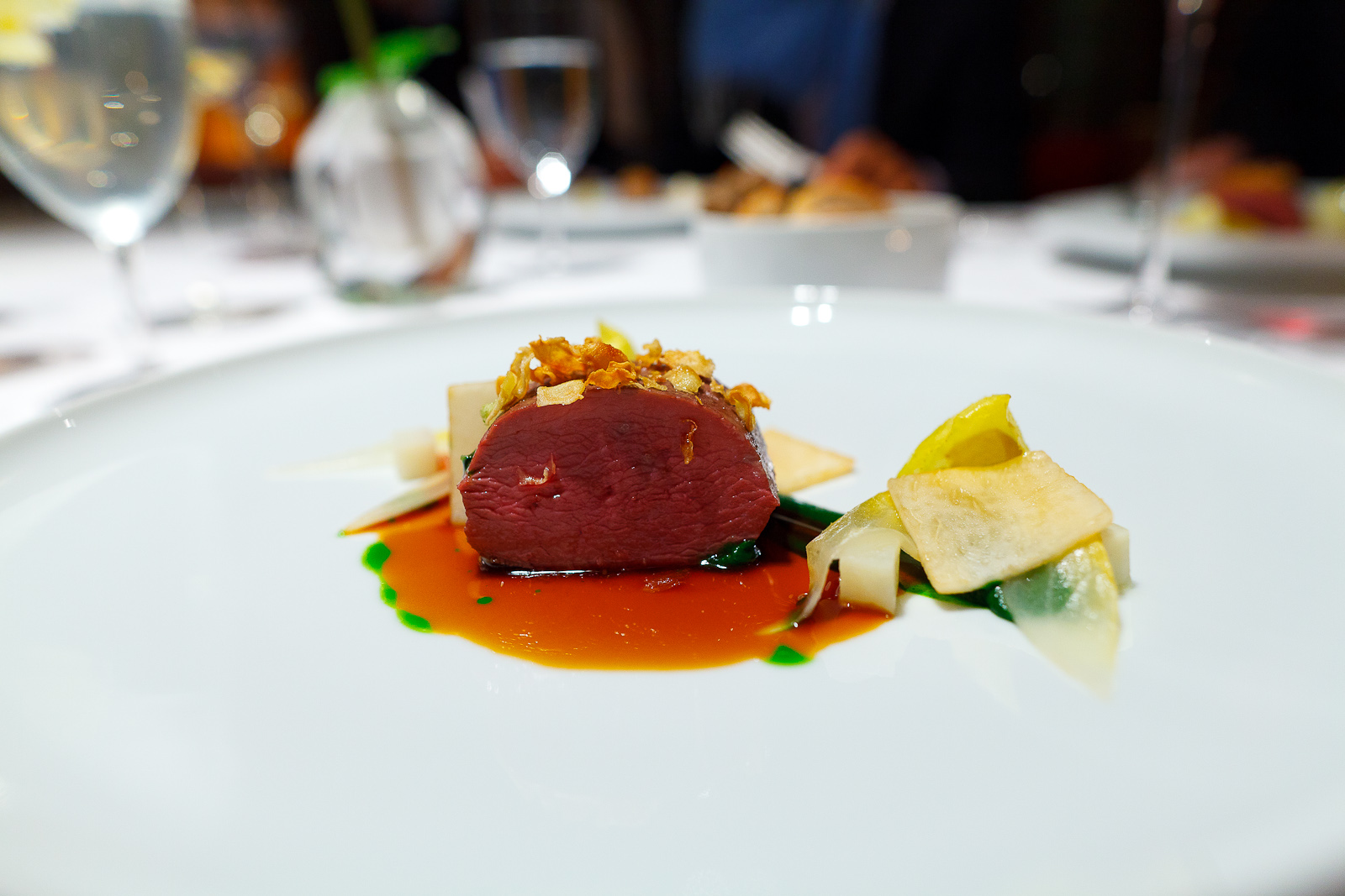 10th Course: Red deer calf from the Altmark region, parsley, vineyard peach and chicory, interior