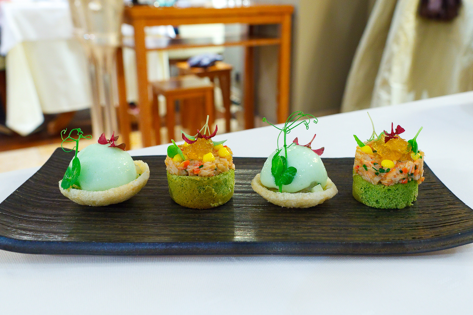 Amuse Bouche 6 and 7: Crab cracker with hamachi, fennel, and apple; Green tea biscuit with lobster and kimizu