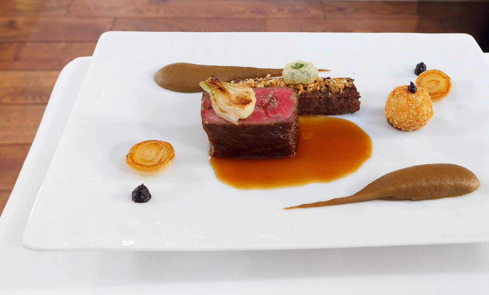 "8th Course: ""Nebraska beef"" - back and short rib, Japanese eggplant, onion, black garlic"