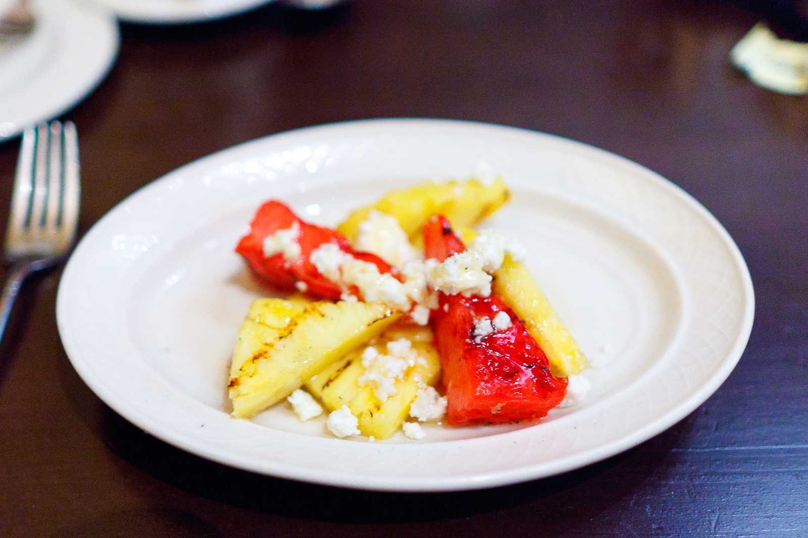 Grilled pineapple and watermelon, feta, honey, crushed pepper ($5)
