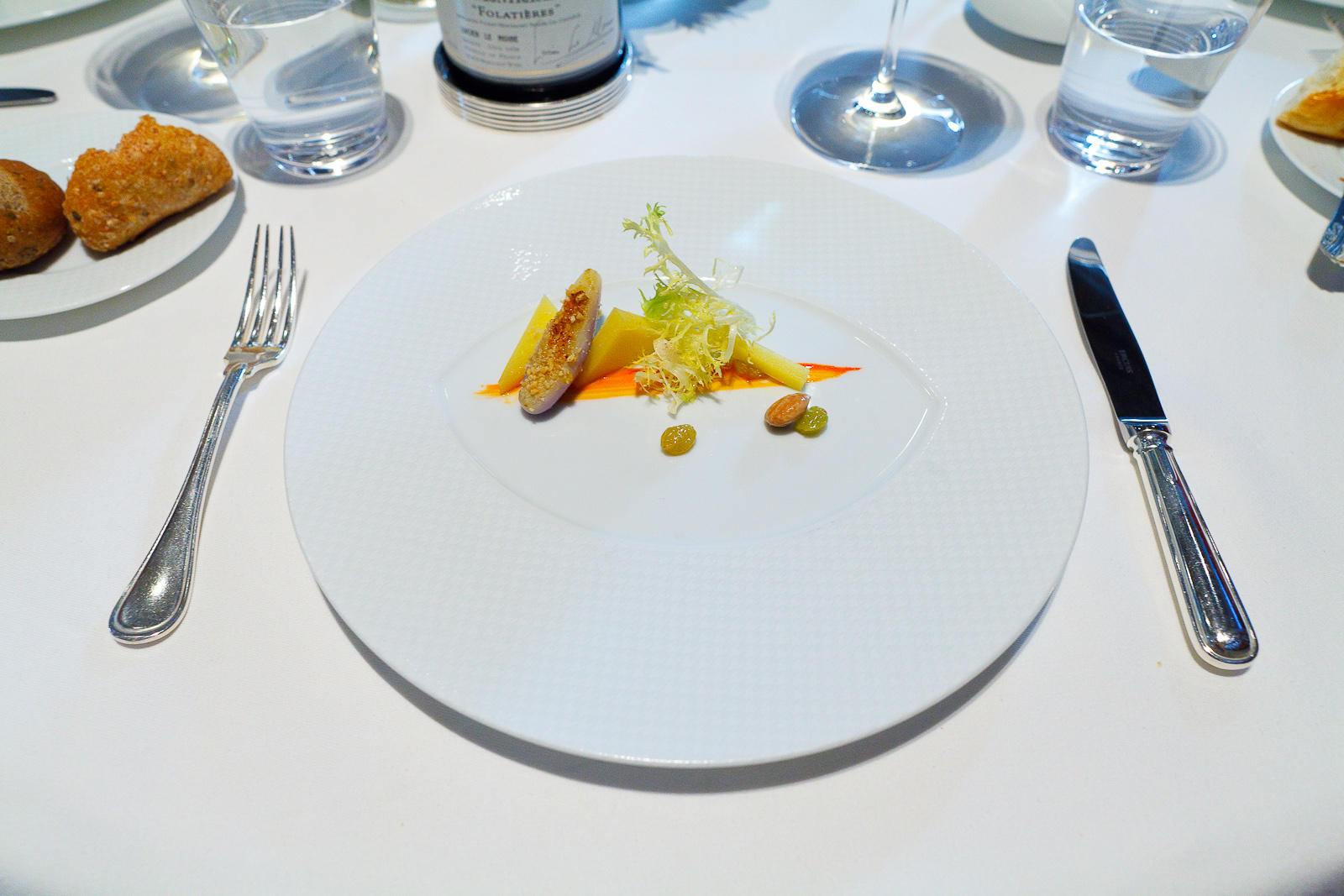 "8th Course: ""Comté Reserve,"" Eggplant, Sultana Raisins, Marcona Almonds, Frisée and Red Snapper Essence"