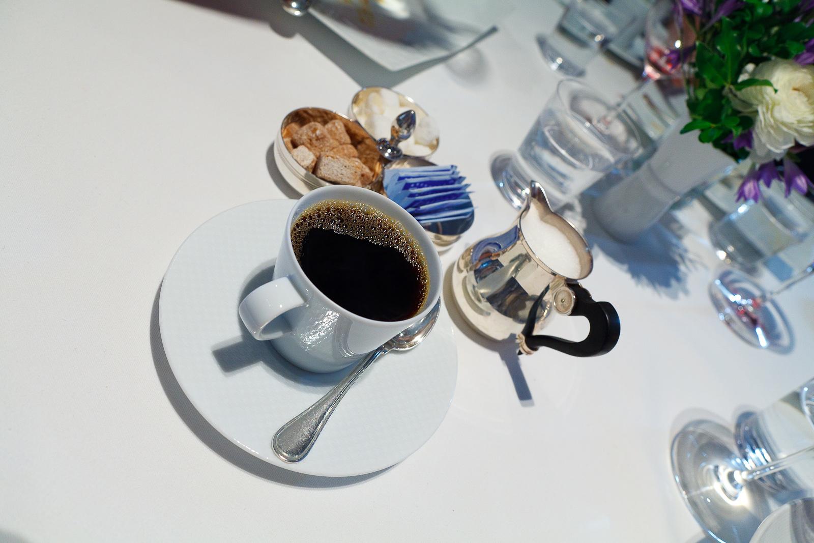 Black coffee, cream, and sugar