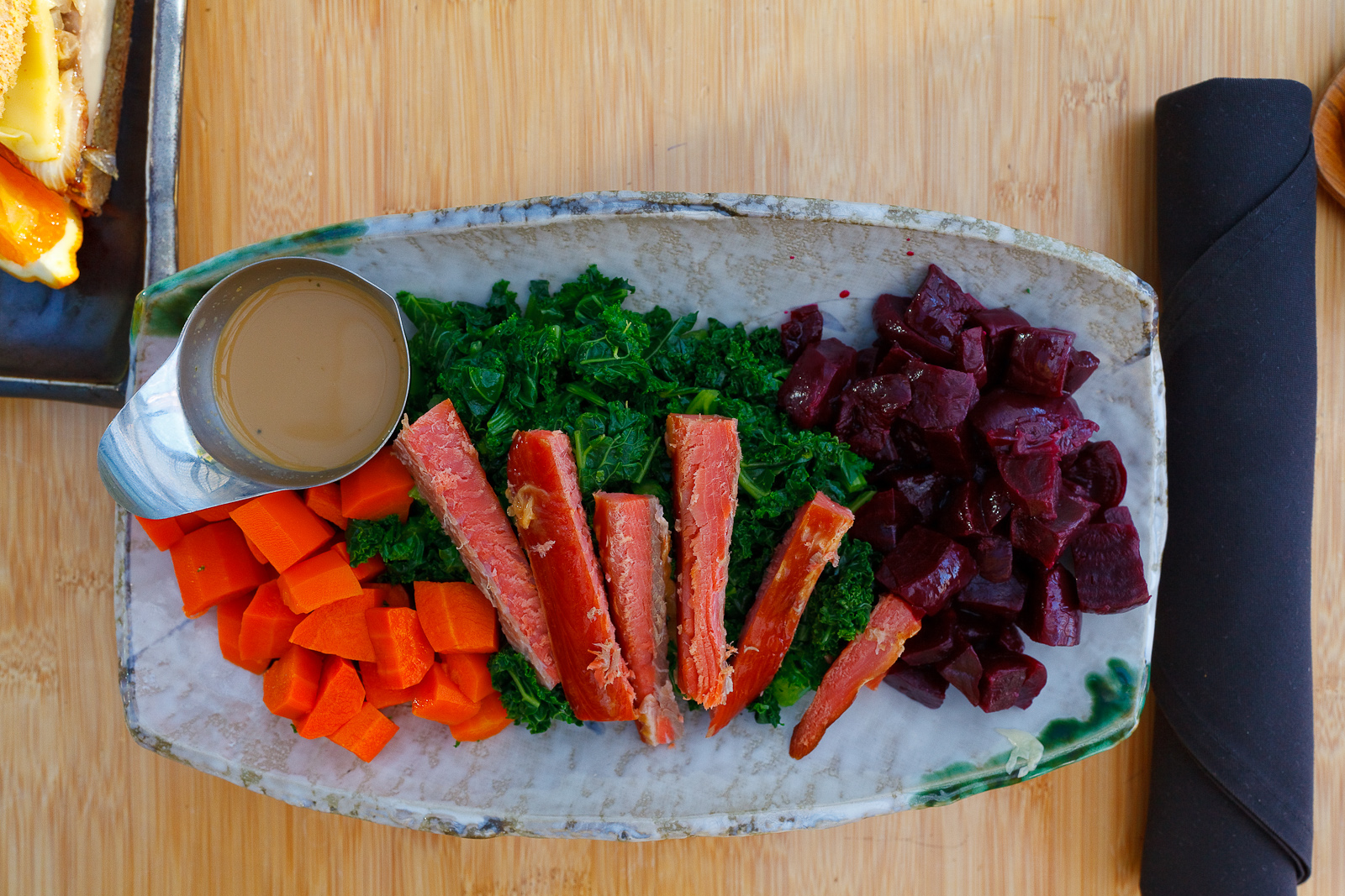 Paleolithic tea service - kale and carrot salad drizzled with tangy sesame dressing, steamed beets, wild salmon ($19)