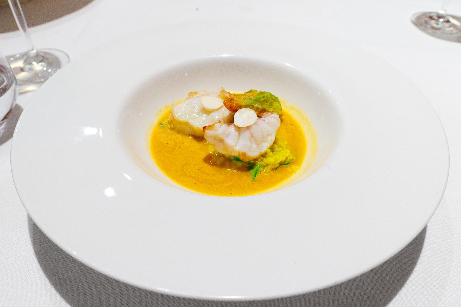 Monkfish with saffron rice and zucchini flower