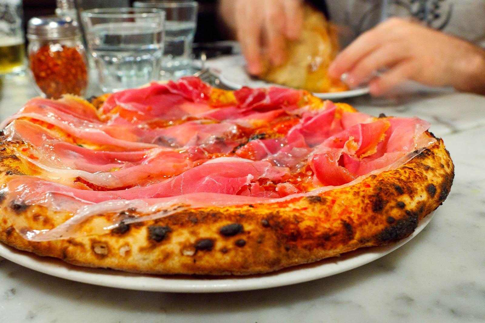 Pizza Soppressata Piccante - tomato, fior di latte, red pepper flakes, garlic ($15)