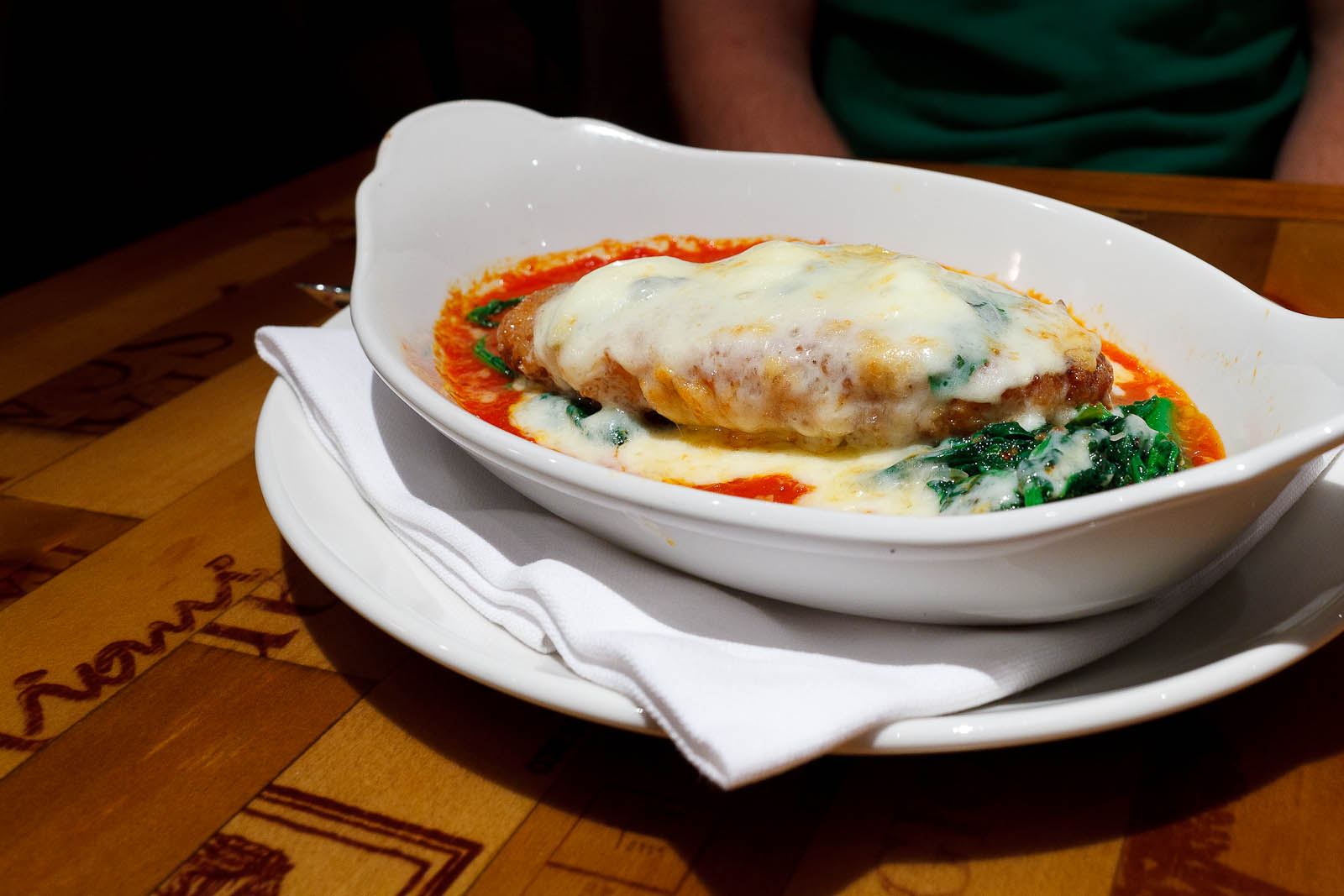 Pollo alla parmigiana - pan fried chicken, buffalo mozzarella, provolone, broccoli raab, tomato sauce ($21)