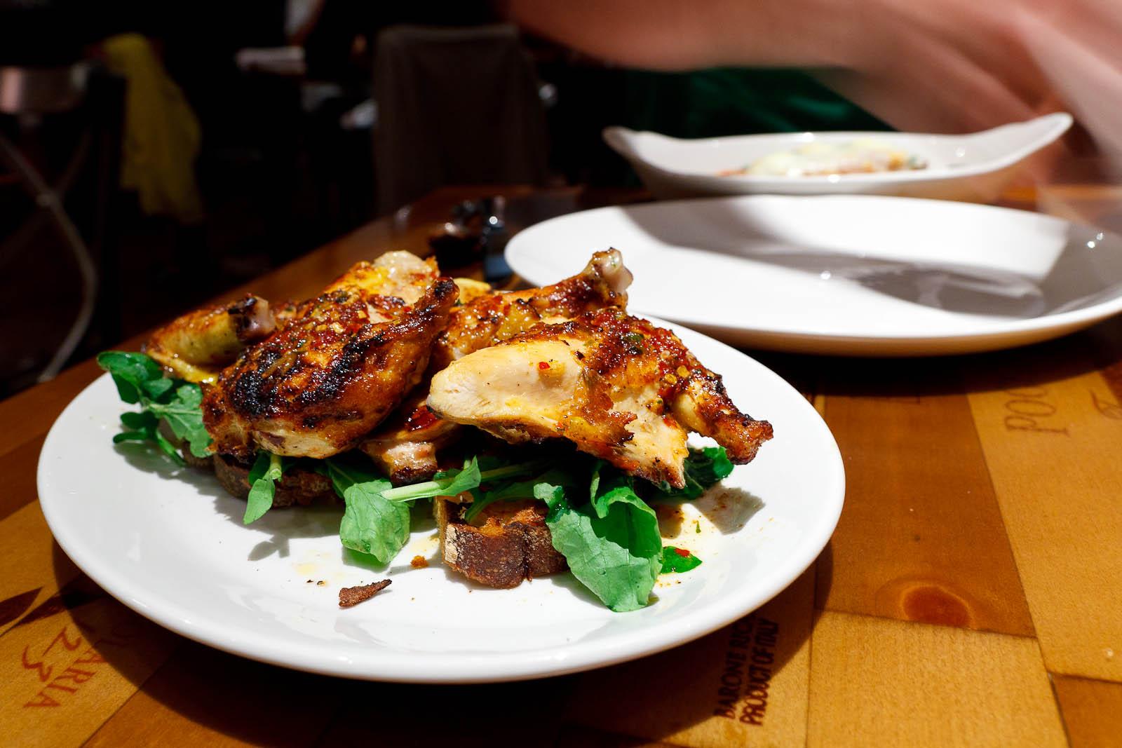 "Polleto alla diavola - grilled spit chicken ""devil style"" - garlic, lemon, hot pepper ($24)"