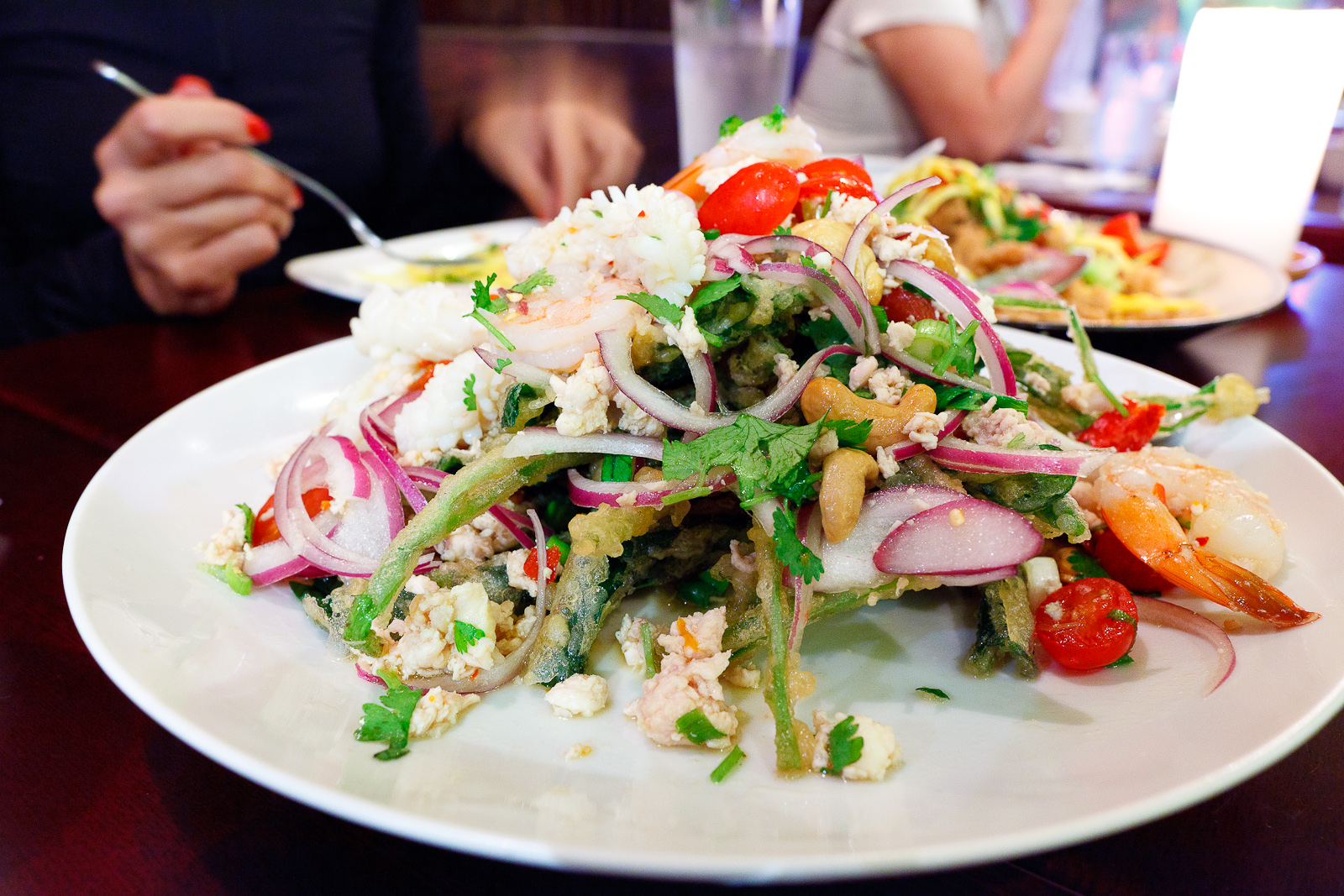 Crispy Chinese watercress salad with chicken, squid, shrimp, and spicy lime dressing ($15)