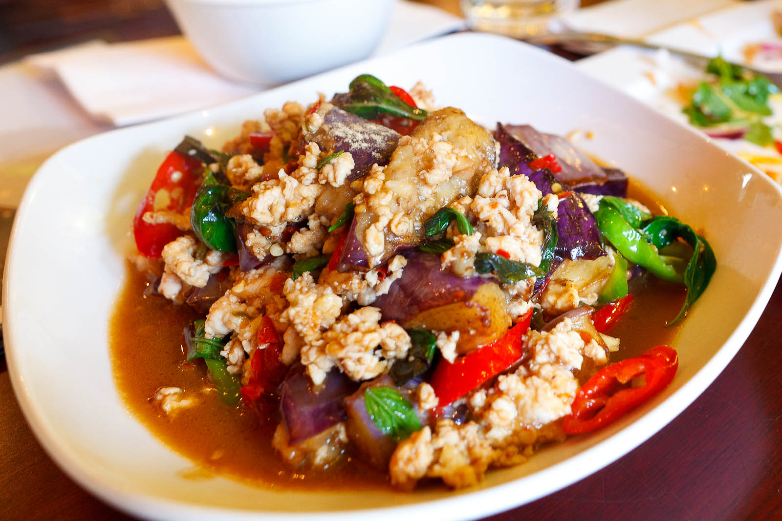 Sauteed eggplant with ground chicken, garlic, chili, and basil leaves ($9)