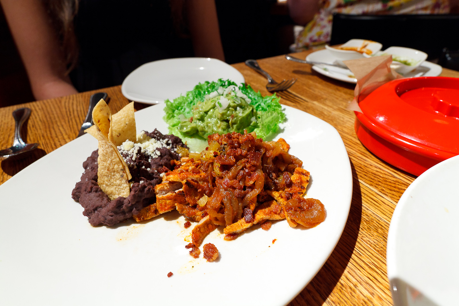 Tacos al pastor, wood-grilled meat sliced and served with two salsas, frijoles charros, guacamole, and homemade tortillas ($18)
