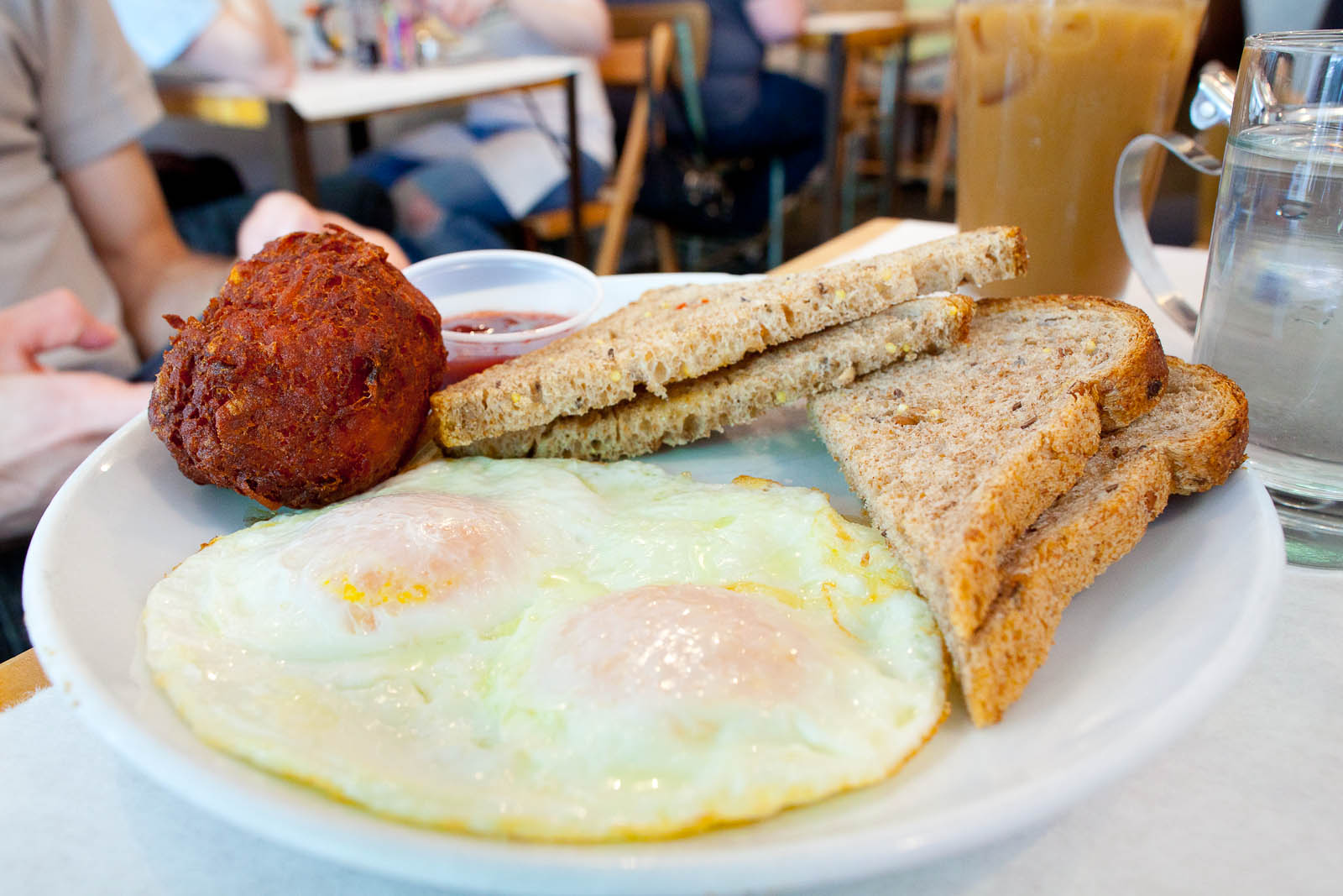 Two eggs over easy with 5-grain toast and hashbrowns ($8.50)