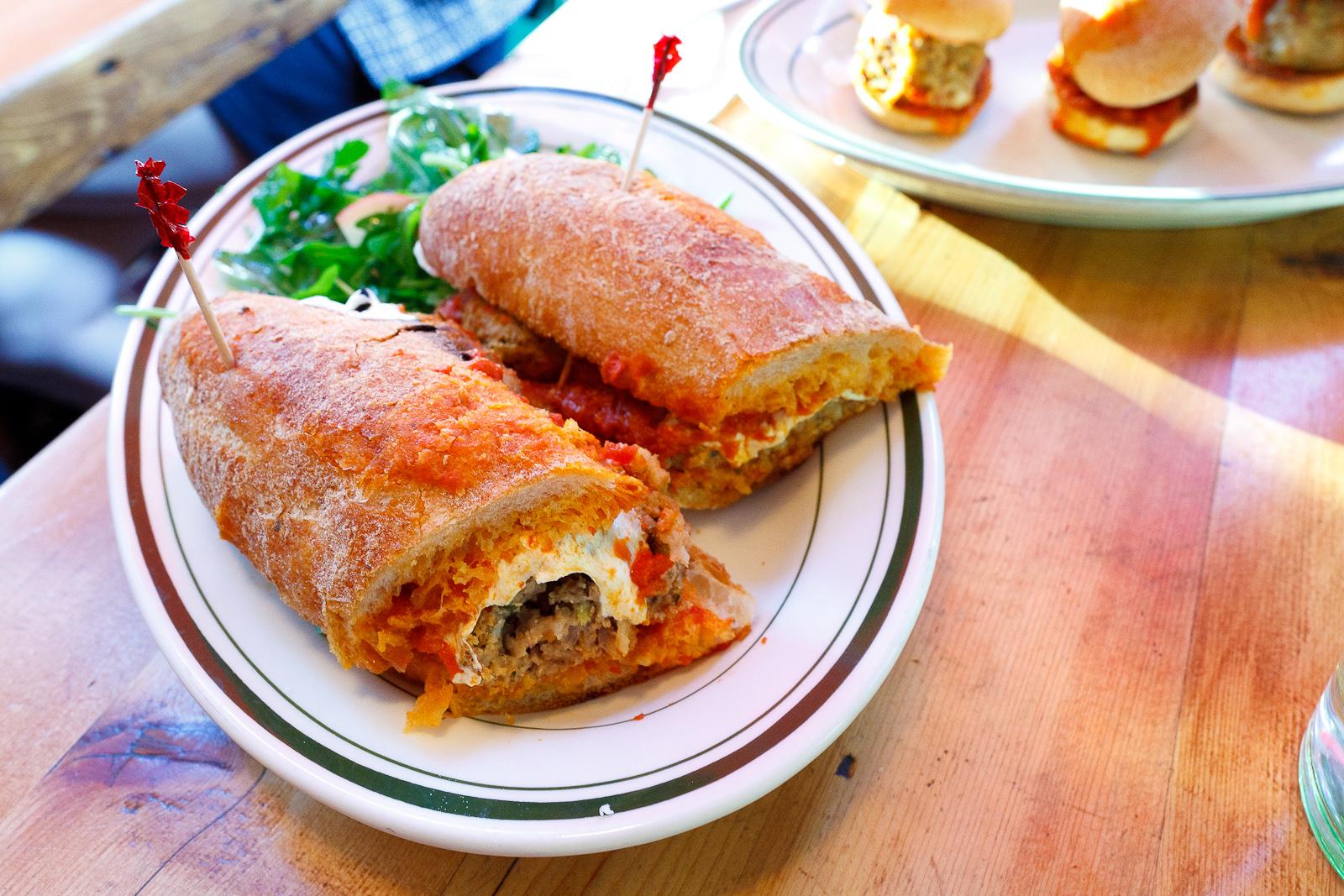 Beef hero, classic tomato sauce, mozzarella cheese, white bread ($9)