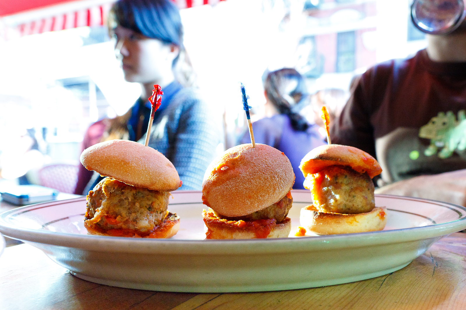 Classic beef, spicy pork, chicken sliders with tomato sauce ($9)