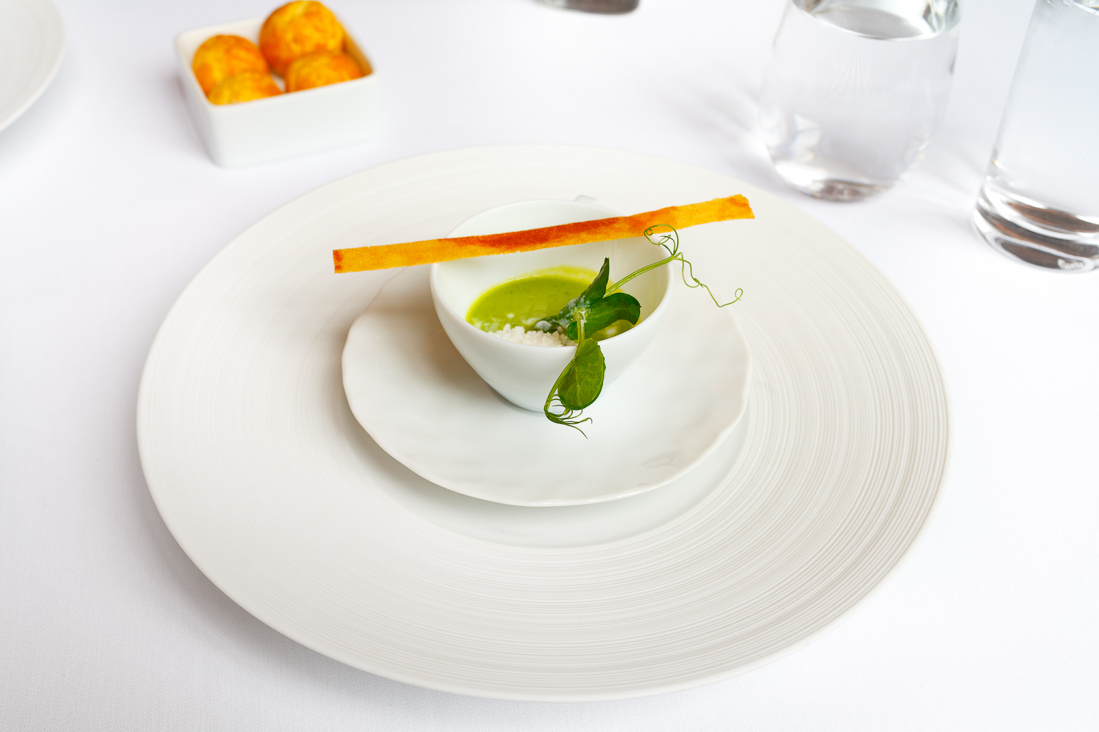 Canape: Chilled pea soup with ham chip