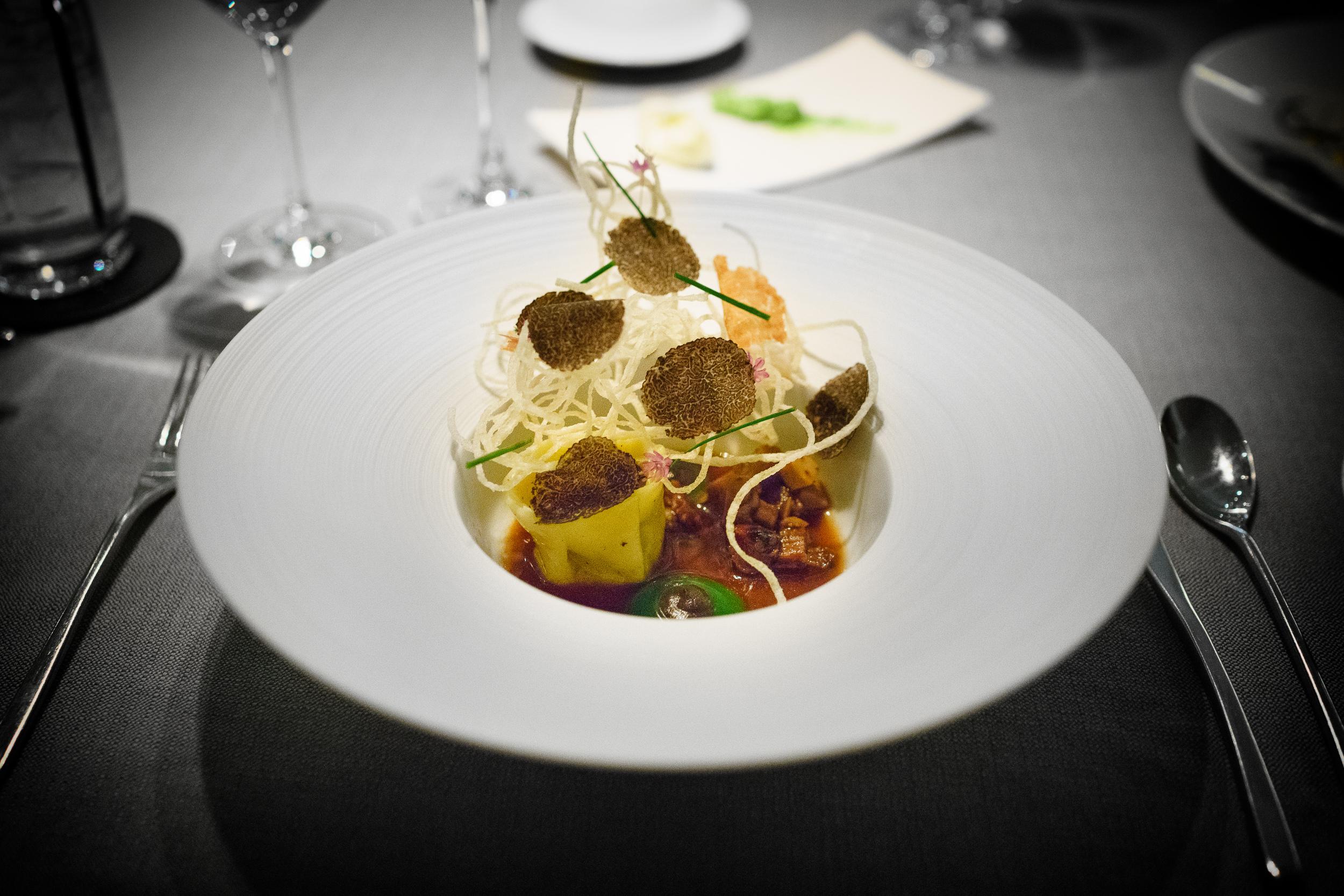 Black truffle, prosciutto, porcini, chive blossom