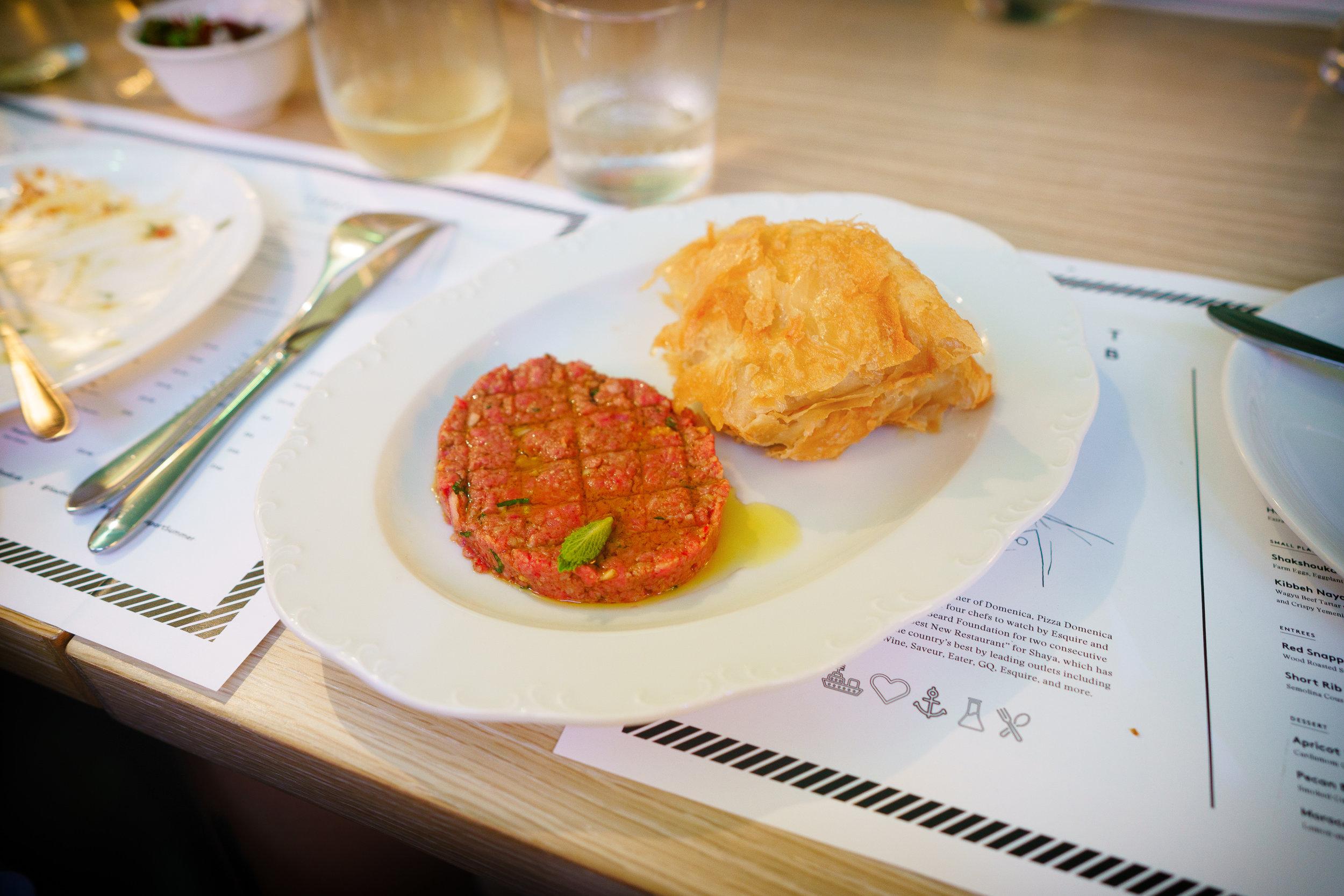Kibbeh Nayah: Wagyu beef tartar w/ pomegranate molasses, Yemenite flatbread