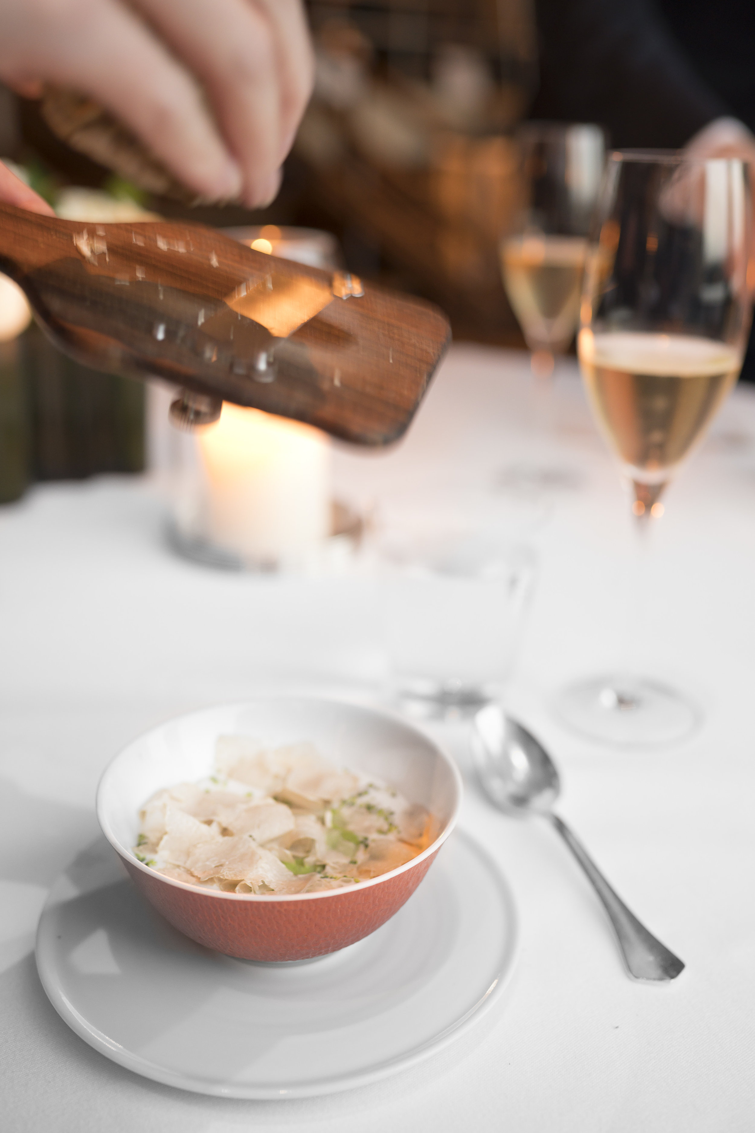 """Cream of Broccoli Soup. """"Pain de Campagne Croutons."""" Piedmont Hazelnuts and Shaved White Truffles from Alba"""