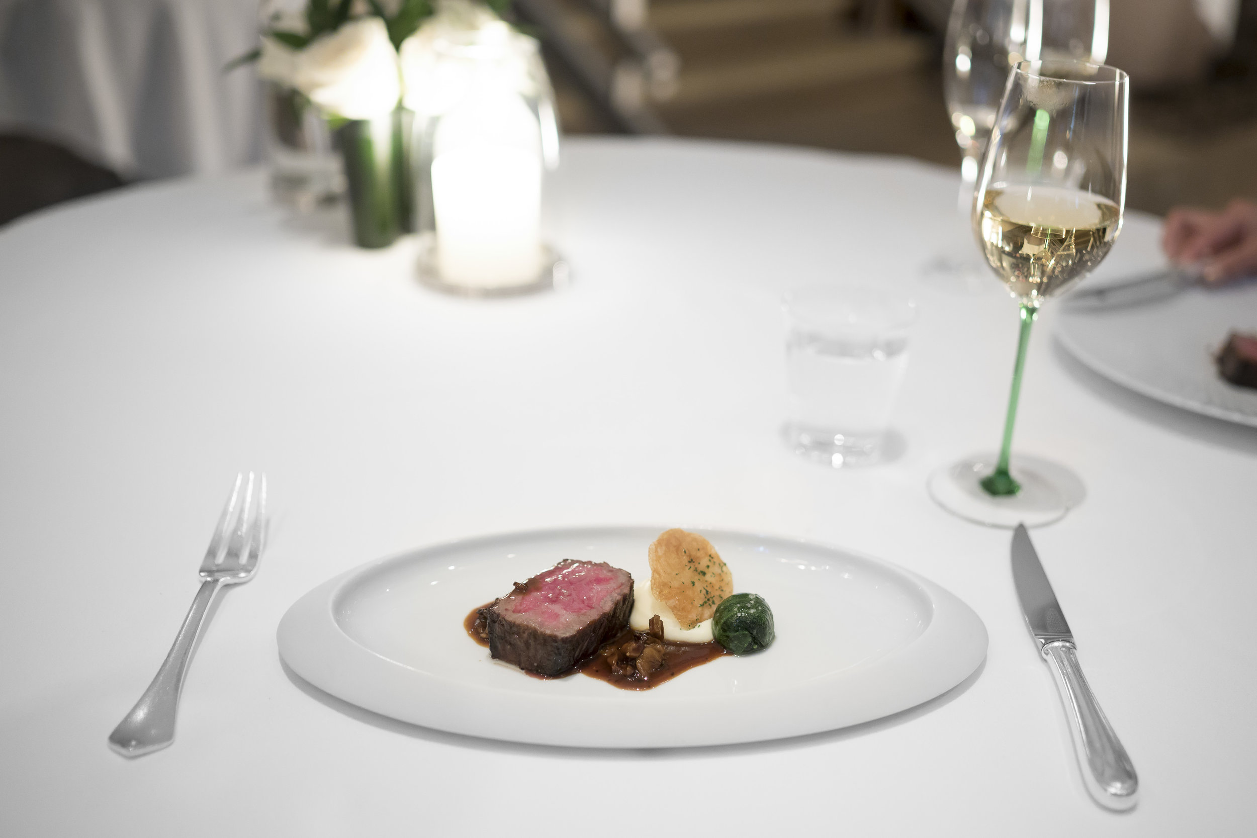 """Charcoal-grilled Miyazaki Wagyu. """"Ris de Veau,"""" Wilted Spinach, """"Pommes Maxim's,"""" and Wild Mushroom-Madeira Cream."""