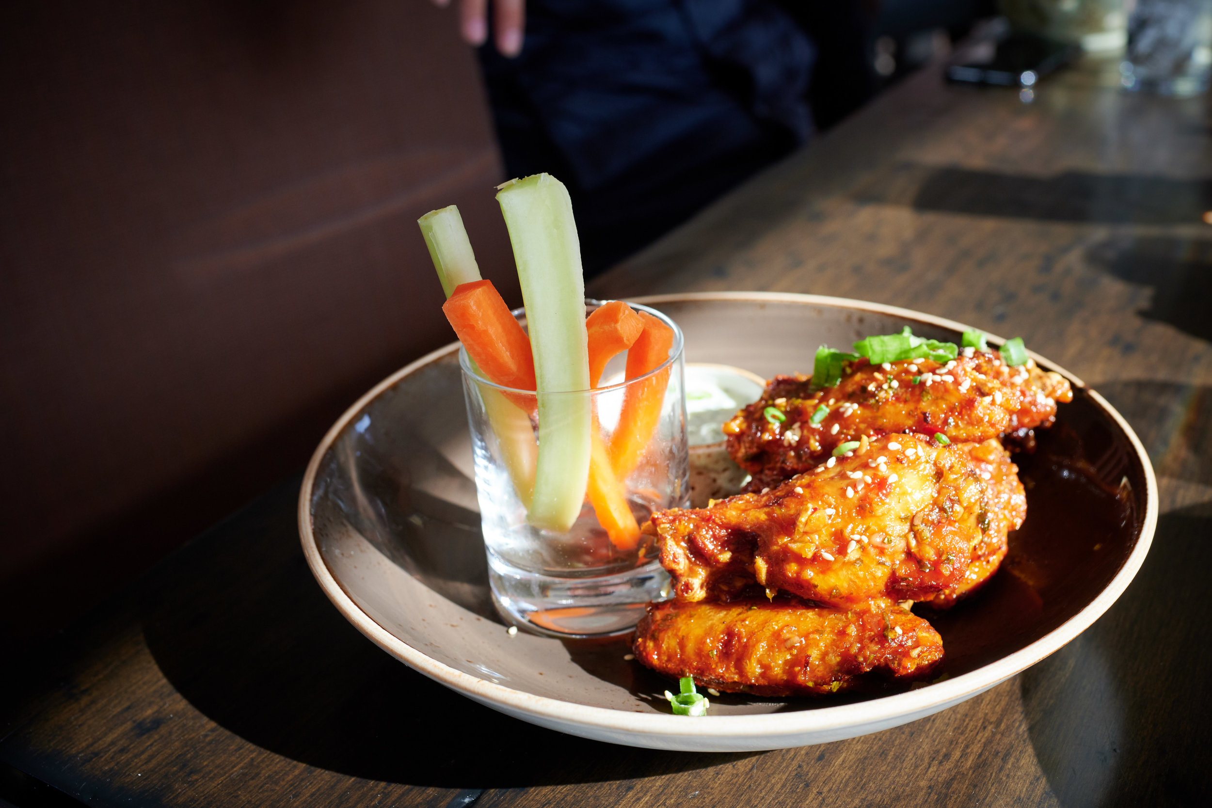 Chicken Wings with Sweet Chili Ginger, Sesame, Cilantro, Carrots, Celery, Buttermilk Cucumber Yogurt at The Farm